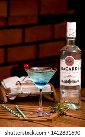 its cocktail time. A glass of cocktail with a bacardi plain in a bar in India
