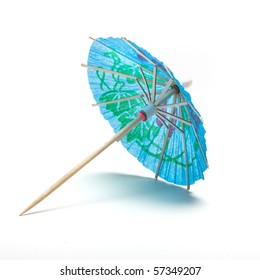 Cocktail Umbrella from low perspective isolated against white background.