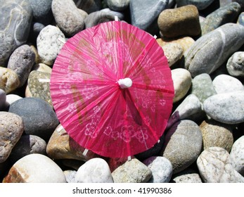 Cocktail umbrella on pebbles