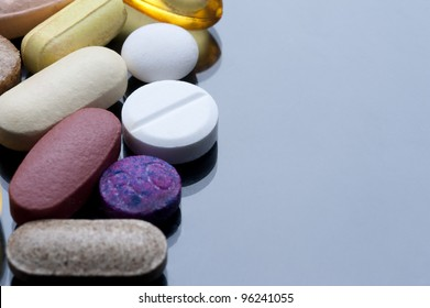a cocktail of various tablets and pills, drugs and health supplements.