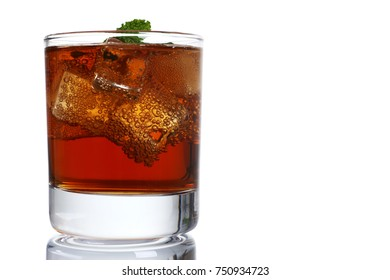 Cocktail whiskey cola with ice and mint in a glass isolated on white background