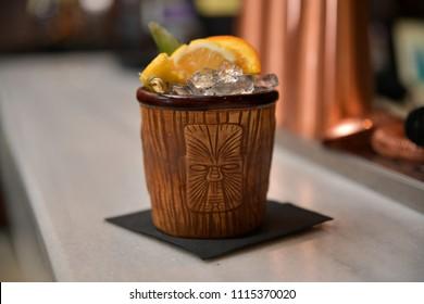 Cocktail with white rum, dark rum, jamaica rum, coconut rum, pineapple juics, orange juice, grenadine, lemon juice, grenadine and lemon juice