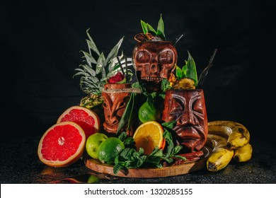 Cocktail Zombie. Tropical cocktails. Tiki Drink Cocktails and fruits on black background.