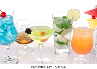 Cocktails with alcohol. Many drinks beverages Blue hawaiian, mojito; Sex on the beach, tropical  Martini, tequila sunrise, margarita, and cognac glass, cocktail umbrella, cherry, lime and pineapple