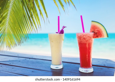 Cocktails in front of beach background