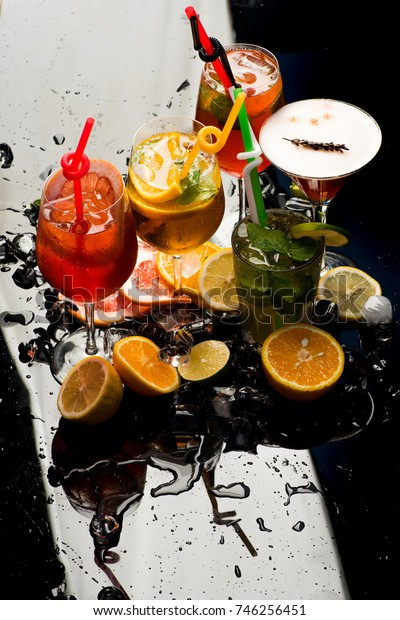 Cocktails isolated on black background with mojito. Party and summer vacation. Drink and food. Fruit slice and cocktail glass at bar. Alcoholic beverage and fruit at restaurant.
