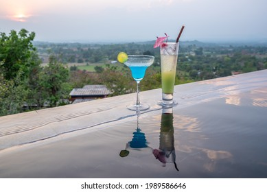 Cocktails near the swimming pool at sunset in Thailand