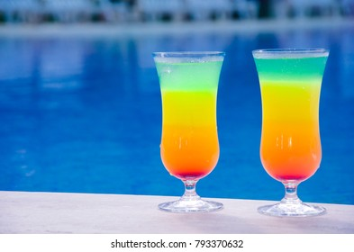 Cocktails on the background of the pool