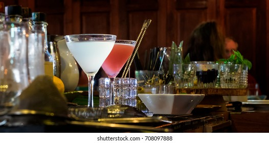 Cocktails on a bar counter ready to be served.
