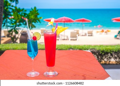cocktails on the beach, clear water white sandy and blue sky. Koh Samui Thailand