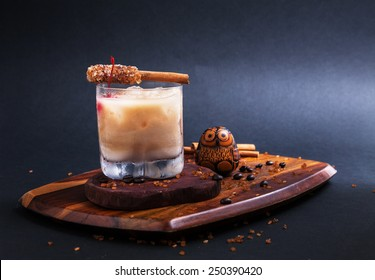 Cocktail/White russian  with  sugar cinnamon stick on wooden  in Black background