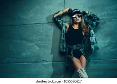 Cocky sexy fashion woman with long hair posing on studio
