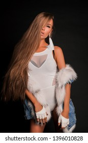 Cocky sexy fashion woman with long hair posing on studio dressed in bodysuit
