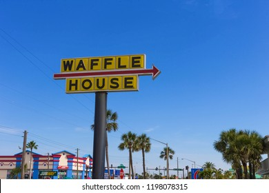 Cocoa Beach, FLORIDA, USA - April 28, 2018: The road sign Waffle House against blue sky. Waffle House, Inc. is an American restaurant chain with 2,100 locations in 25 states in the United States.