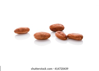 Cocoa beans isolated on white background. Healthy superfood.