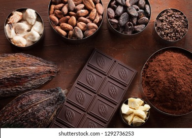Cocoa beans pods, chocolate bar pieces and cocoa powder