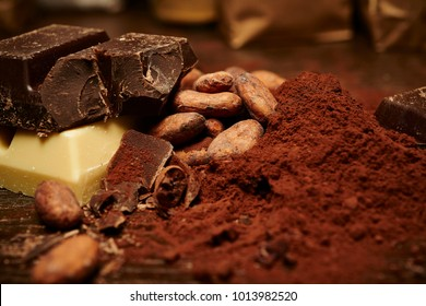 cocoa beans and powder, pieces of dark and white chocolate