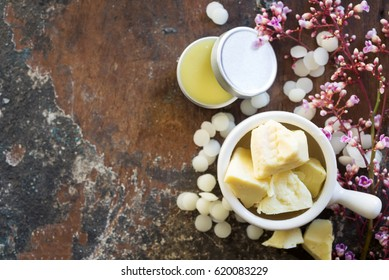 cocoa butter in white ceramic pot prepare for D.I.Y. projects, homemade natural lip balm.