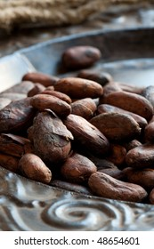 Cocoa (cacao) beans on iron dish, close-up
