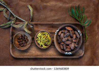 Cocoa, cardamom and coffee beans on natural background.