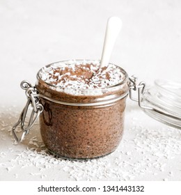 Cocoa chia seed pudding on a bright background.