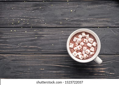 Cocoa chocolate cup with hot drink and white marshmallow on wood desk cozy background, cacao in mug on brown wooden rustic table, holiday coffee house shop, above top overhead view, copy space - Shutterstock ID 1523722037