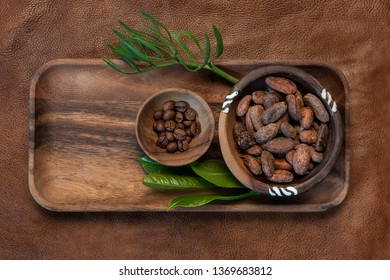 Cocoa and coffee beans on natural background.