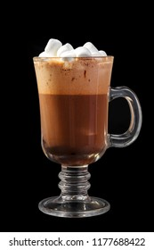 Cocoa, coffee with whipped cream, marshmelow, marshmallow in a high glass glass, side view, isolated black background