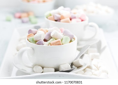 cocoa with colorful marshmallow in white cups, closeup, horizontal