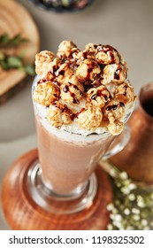 Cocoa Drink with Whipped Cream and Caramel Popcorn in Tall Glass Served in Restaurant. Cacao Milkshake, Frappuccino or Hot Chocolate with Milk, Lavender Syrup and Marshmallow