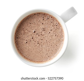 Cocoa drink in white mug isolated on white background, top view