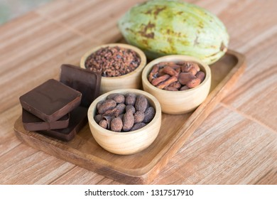 cocoa mass with Cocoa beans and Cocoa Nibs on wooden