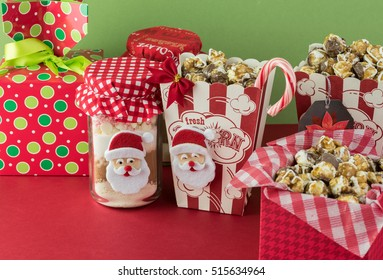 cocoa mix jars and caramel popcorn boxes decorated for christmas gifts