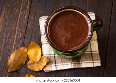 cocoa on the old wooden background