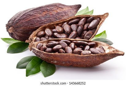 Cocoa pod with cocoa beans and leaves isolated on a white background.