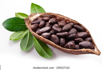 Cocoa pod and cocoa beans on a white background.