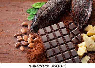 Cocoa pods, beans and powder with chocolate bar pioeces and cocoa butter