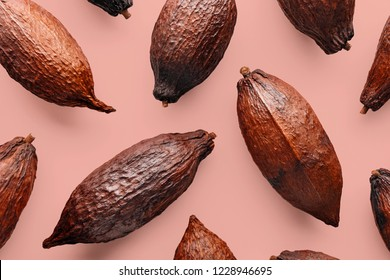 Cocoa pods on a pink background, creative flat lay food concept
