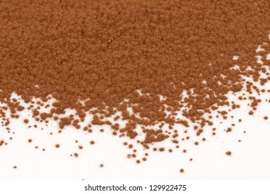 The cocoa powder close up at the white background