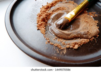 cocoa powder with honey close up - healthy skincare
