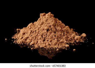 Cocoa powder isolated on black background with reflection