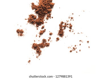 cocoa powder isolated and scattered on white
