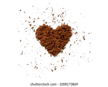 Cocoa powder spilling in heart shape isolated on white background