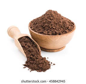 Cocoa powder in a wooden bowl isolated on white