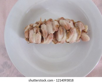 Cocoa pulp on white plate
