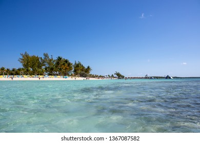 CocoCay, Bahamas Sandy beach with people enjoying sun and fun on a sunny day at this tropical island.