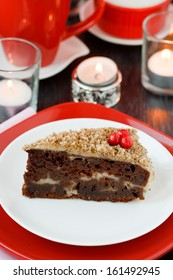 Cocolate cake with nuts on a red background. New Year's cake.