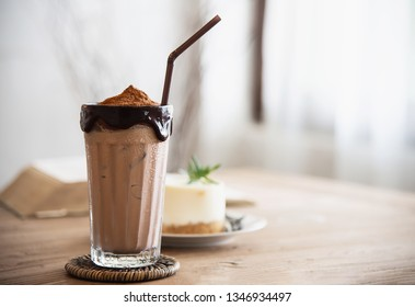 Cocolate cocoa blend with cake in coffee shop - dessert background concept