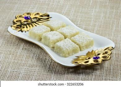 Coconut Barfi - Khoa aur Nariyal ki Barfi (an Indian sweet dish made with concentrated whole milk and grated coconut).