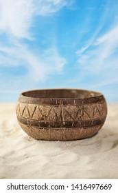 Coconut bowl by beach, zero waste